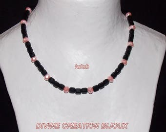Complete set including necklace earrings and bracelet made of glass beads.