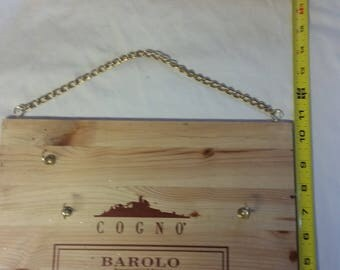 Wooden wine box lid re-prposed into a key holder!