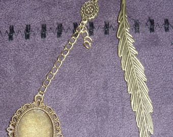 A personalized, metal feather bookmark