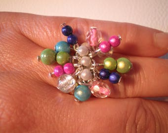 01710 - Multicolor ring with magic beads and glass beads