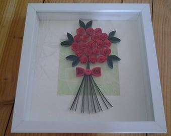 table quilling depicting a bouquet of roses