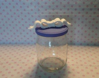 Glass jar with a white bow