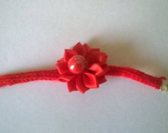 Wool bracelet made by knitting.