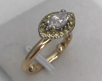 Marquise cut diamond, pure intense yellow round diamonds, yellow gold, platinum