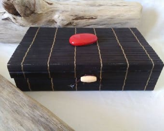 wooden box with black bamboo