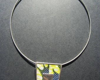 The fabric of yellow and silver Choker