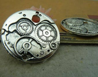 a silver COG steampunk watch