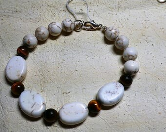 Magnesite ( known as white turquoise) and tigers eye 8 inch bracelet.