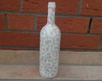 decorative wine bottle in the vintage/shabby look, such as vase or candle holder