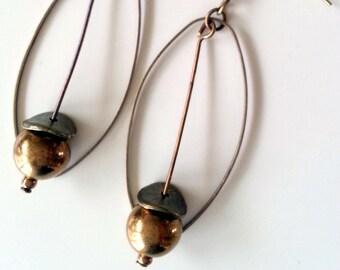 Tan earrings 1