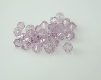 Lot 151 x Pearl spinning swarovski crystal light amethyst 4mm