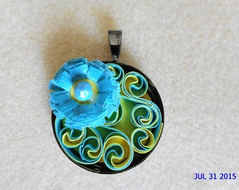 Quilling circular pendant turquoise blue and pale yellow