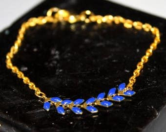 Midnight Blue spike chain bracelet and gold chain.