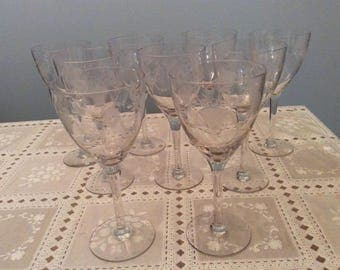 Vintage wine glasses etched with flower baskets