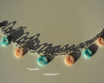 Pink charm bracelet, and powder blue frosted snowflakes