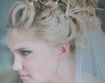 Peak bun white pearls and ostrich feathers