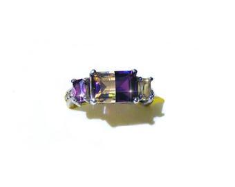 Trés jolie bague argent 925 cristal améthrine à facette de 10x7 mm et pierre citrine et améthyste de 5 mm.