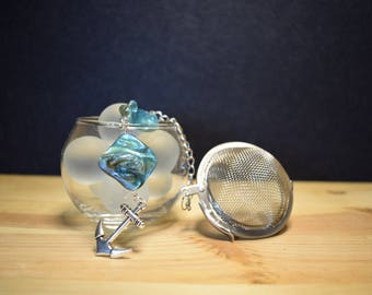 Infuser for tea and herbal teas with anchor pendant and blue Pearls