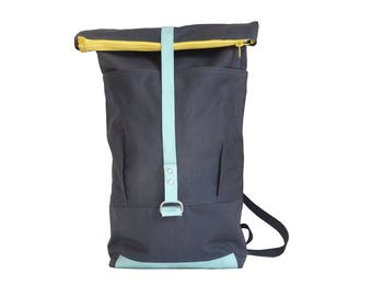 Elegant blue grey leather and canvas backpack