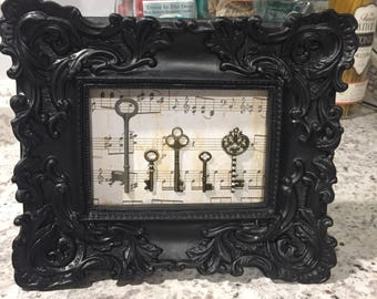 Antique Keys In An Ornate Baroque Frame