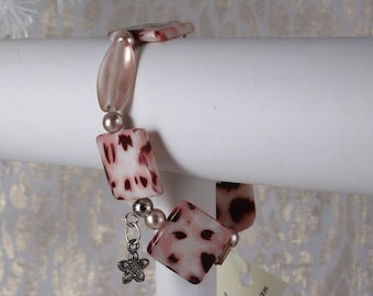 "Flat Square Animal Print Beads. Deep Copper Ball Spacers. Copper Tassel Charm. Stretch Bracelet. 6.5"" Diameter."