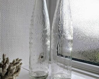 Rare glass bottles with embossed Shamrock details.