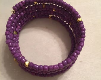 Purple memory wire bracelet with gold hearts