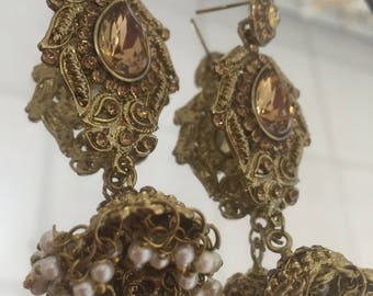 Indian bollywood gold jumka style earrings with white pearls