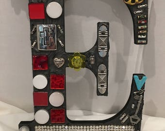 Alphabet E, Eclectic letter E, mosaic letter E, Initial E, with glass tiles, assorted charms, large and small key, cloisonne pieces, handle