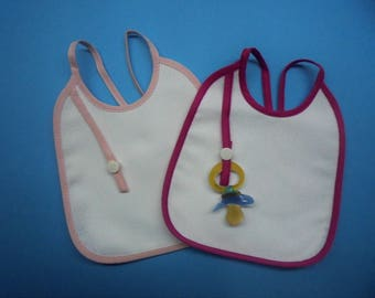 2  baby bibs to embroidered