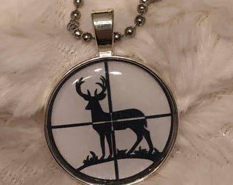 Deer in scope cross-hairs necklace