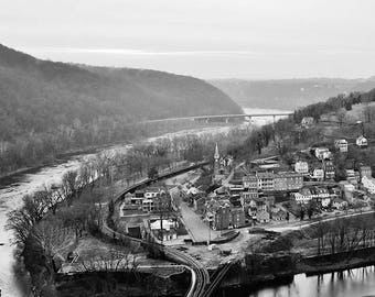 A black and white photo overlooking Historic Harpers Ferry, West Virginia.