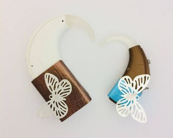 """Jewelry for devices hearing cochlear """"Butterfly""""."""