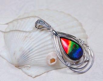 Ammolite pendant.Large Grade AA rainbow teardrop--Once seen not forgotten.#061327