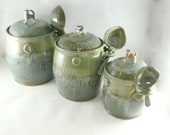 Reserved for Leanna: Three Kitchen Ceramic canisters set with scoops , cookie jar, lidded storage jars flour, sugar, coffee, pet food