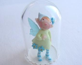 Tiny fairy figurine in a globe