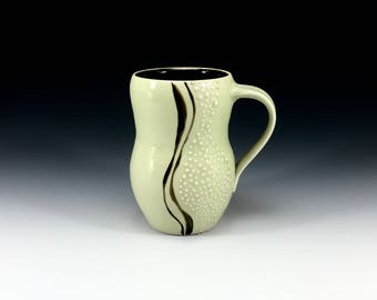 Pale sage green glazed curvy porcelain (tall) mug with slip trailed dots. Handmade porcelain pottery cup for coffee, tea or cocoa (#2)