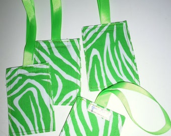 Green and white zebra-striped fabric luggage tag