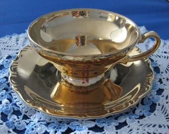 """JAPANESE """"All Over Gold"""" Porcelain Teacup and Saucer"""