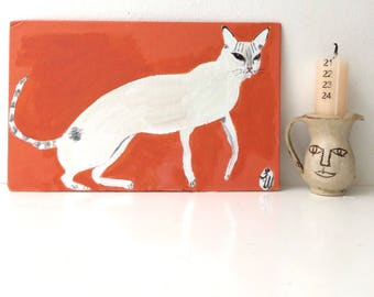 Painting on reclaimed canvas board book cover of a white cat