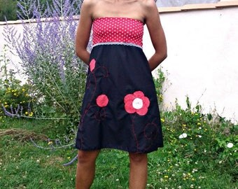 Red and black Haziel bustier dress and polka dot flower
