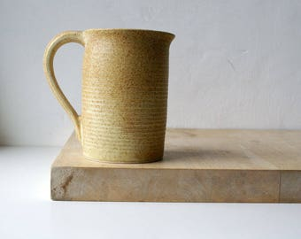 Straight sided pouring jug - wheel thrown and glazed in natural brown