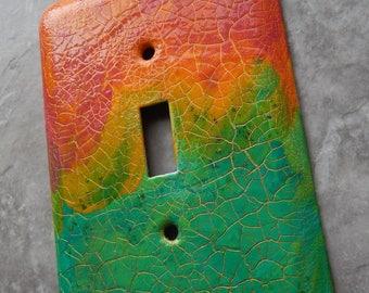 Summer Morning, abstract mixed media painting on metal switch plate cover, blue greens, yellow, orange, dark coral colors