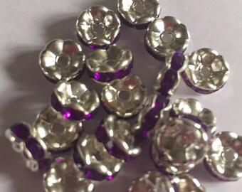 Set of 22 Grade A purple rhinestone spacer beads. 7x3mm