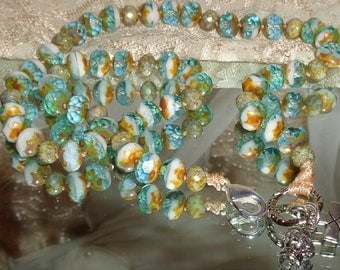 Bohemian sand and sea blue healing hand knotted silver cross and crown  necklace Pamelia Designs Sacred Jewelry