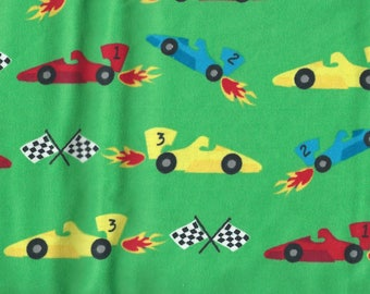 """RACE CARS on Green Background Flannel Fabric, 1 yard x 42"""" inches wide.  Brand new."""