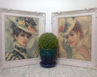 2 vintage Strevens (Huldah style) framed prints, mid-century white molded plastic frames. Pair of ladies; hats, gloves. Parisian glamour.