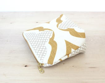Small zip pouch mustard and white sand