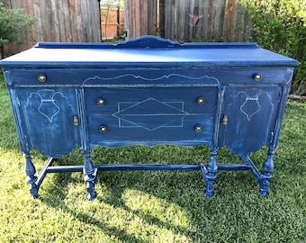 Antique blue jeans buffet painted like denim