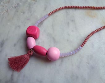 Blush pink beaded tassel necklace on leather cord